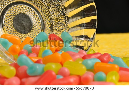 Candy spilled out of bowl - stock photo