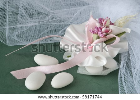 candy wedding favors and packaging materials on a green background - stock photo