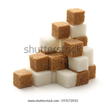Cane and white sugar cubes - stock photo