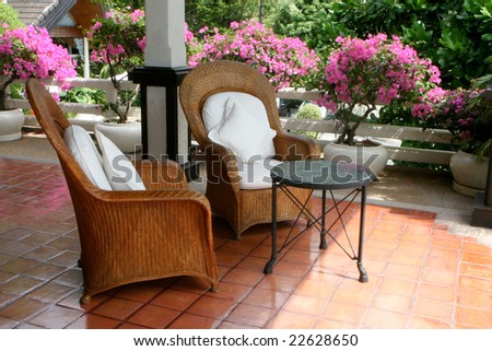 Cane and wooden furniture - home interiors. - stock photo