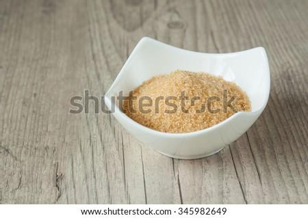 cane brown sugar in white bowl  - stock photo