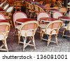 cane chairs and red table in paris outdoor cafe - stock photo