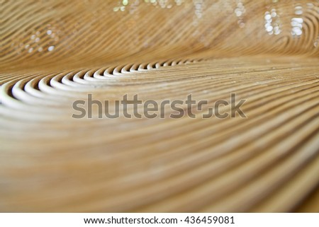 Cane or wickerwork background- showing the details of interlaced weave structure of basket or furniture,Abstract background from natural rattan. Handmade weaving. - stock photo