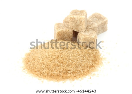 Cane sugar and sugar cubes on white background - stock photo