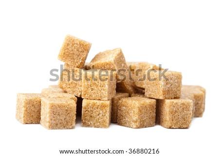 cane sugar cubes isolated - stock photo