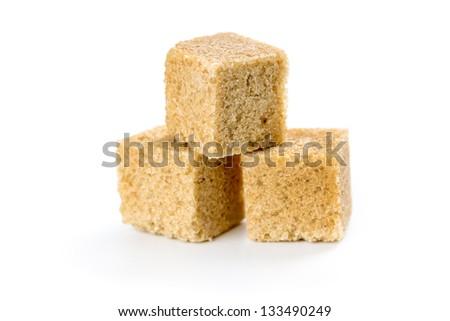 Cane sugar cubes isolated on white background - stock photo