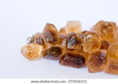 Cane sugar cubes on the white background