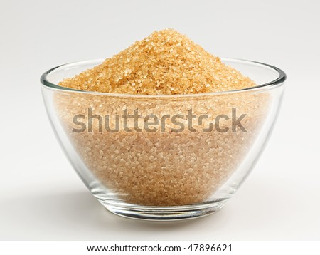 Cane sugar in a glass bowl - stock photo