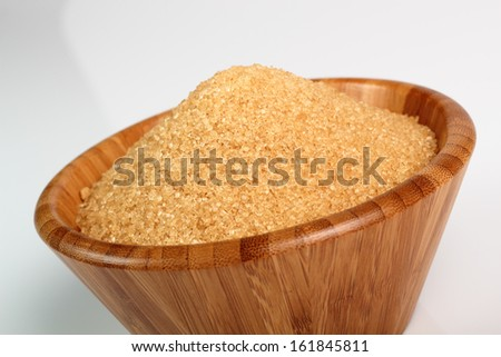 Cane Sugar in wooden bowl
