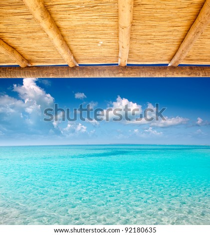 Cane sunroof with tropical perfect beach of turquoise water view [ photo-illustration ] - stock photo