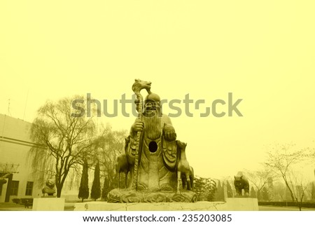 CANGZHOU - DECEMBER 8: stone carving antarctic god man in the WuQiao acrobatics world scenic spots, on december 8, 2013, cangzhou, hebei province, China.   - stock photo