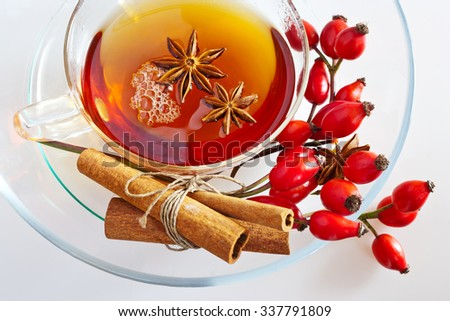 canina rosa healing tea with ripe red berries / rose hip drink / Pometum - stock photo