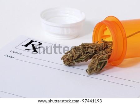 Cannabis bud sitting on a prescription pad - stock photo
