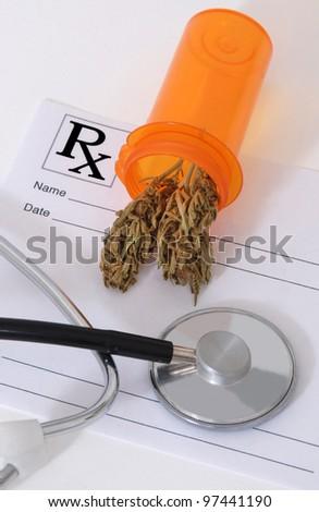 Cannabis bud sitting on a prescription pad, near a stethoscope - stock photo