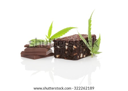 Cannabis chocolate and cannabis brownie with ganja leaf isolated on white background.  - stock photo