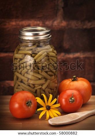 canned beans on wood counter - stock photo