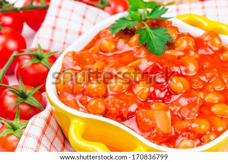 Canned beans with vegetables in tomato sauce - stock photo