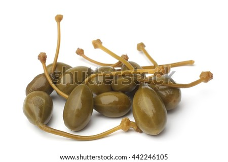 Canned capers on white background - stock photo