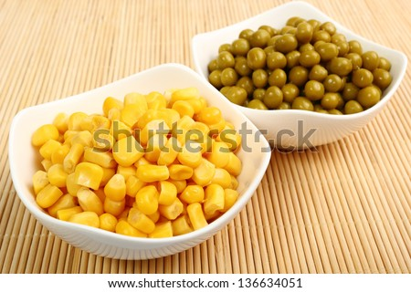 Canned Corn and Canned Green Peas - stock photo