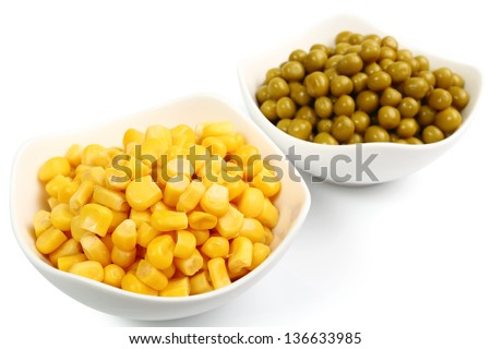 Canned Corn and Canned Green Peas. Isolated with clipping path. - stock photo