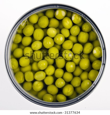Canned green peas isolated on white background - stock photo
