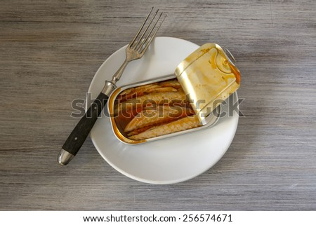canned mackerel in brine, on wood white background - stock photo
