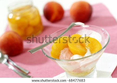 Canned peaches with ice cream - stock photo