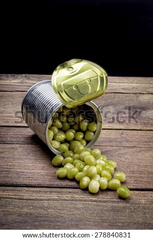 Canned Peas on vintage wooden background - stock photo