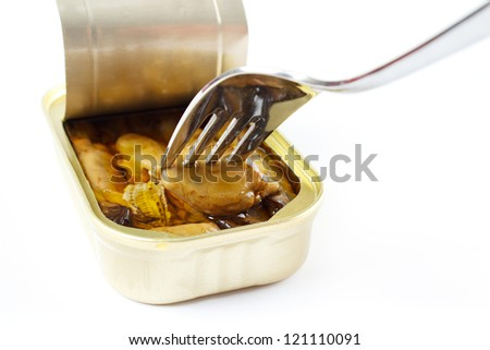Canned smoked oysters with fork, isolated on white with shadow