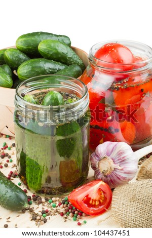 canned tomatoes and cucumbers, homemade preserved vegetables - stock photo