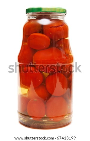 Canned tomatoes in a glass jar on white background - stock photo