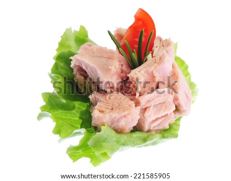 Canned tuna chunks with green salad and tomato - stock photo