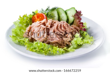 Canned tuna with vegetable salad isolated - stock photo