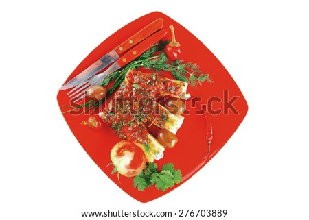 cannelloni in yellow cheese served with pepper and tomato - stock photo