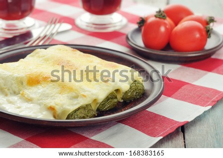 Cannelloni stuffed with spinach and ricotta with sauce bechamel