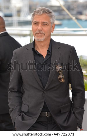 "CANNES, FR - MAY 12, 2016: Actor George Clooney at the photocall for ""Money Monster"" at the 69th Festival de Cannes."