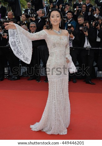 "CANNES, FR - MAY 11, 2016: Actress Gong Li at the gala premiere of Woody Allen's ""Cafe Society"" at the 69th Festival de Cannes."