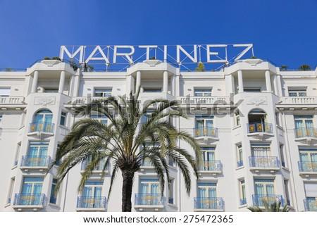 CANNES, FRANCE - APRIL 12, 2015: Grand Hyatt Cannes Hotel Martinez in Cannes at Boulevard de la Croisette. The Grand Hyatt Cannes Hotel Martinez is a famous art deco style Grand Hotel. - stock photo