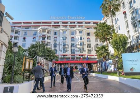CANNES, FRANCE - APRIL 12, 2015: The Hotel Majestic Barriere in Cannes at Boulevard de la Croisette. The Hotel Majestic Barri�¨re is a historic luxury hotel. - stock photo