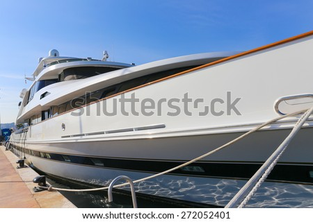 CANNES, FRANCE - APRIL 12, 2015: Yacht anchored in Port Pierre Canto at the Boulevard de la Croisette in Cannes, France.  Cannes is synonymous with glamour thanks to its world-famous film festival. - stock photo