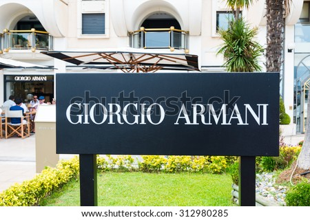 CANNES,FRANCE-AUGUST 01,2015:Giorgio Armani its new fashion boutique on La Croisette with an added Armani/Caffe dining area. Is an international Italian fashion house headquartered in Milan, Italy. - stock photo