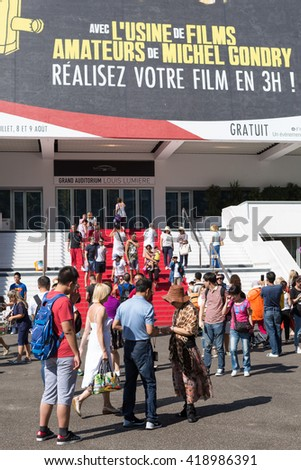 CANNES, FRANCE - AUGUST 17, 2015: People in front of the Cannes Film Festival theater. Cannes is one of the bigest French tourist cities and home to annual film festival.