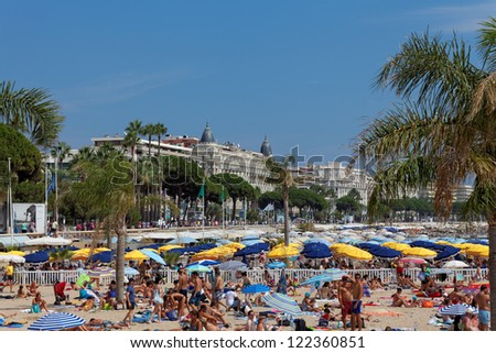 "CANNES, FRANCE - AUGUST 13: View of the beach and Luxury hotel ""InterContinen tal Carlton"" Cannes features 343 rooms, located on the famous ""La Croisette"" Boulevard in Cannes, France; August 13, 2012"