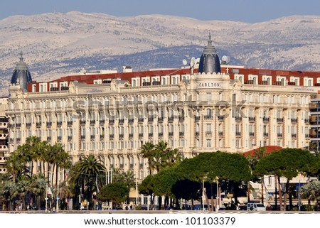 CANNES, FRANCE - FEBRUARY 1: Carlton Palace facade shown on February 1, 2012 in Cannes, France. Carlton hotel is a luxury hotel containing 343 rooms, located on the famous festival film town. - stock photo
