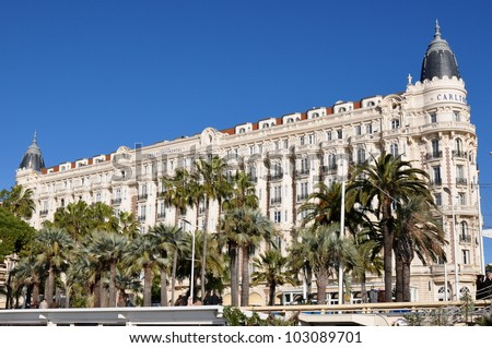 CANNES, FRANCE - JANUARY 6: Carlton Palace facade shown on January 6, 2012 in Cannes, France. Carlton hotel is a luxury hotel containing 343 rooms, located on the famous festival film town. - stock photo
