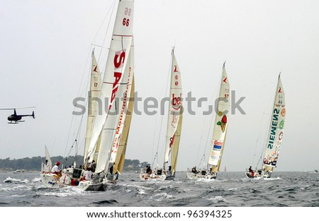 CANNES, FRANCE - JULY 23: Cannes-Istanbul Figaro Yacht Race. Yachts are struggling for first place, July 23, 2006. Cannes, France - stock photo