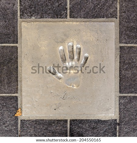 CANNES, FRANCE - JUN 25, 2014: Sophie Loren hand mark on the alley of fame in Cannes, Cote d'Azur, France - stock photo