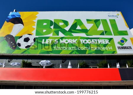 CANNES, FRANCE - JUNE 20: Facade conference hall shown on june 20, 2014 in Cannes, France. Bill-posting realized to celebrate the 2014 FIFA world cup and the Brazil, organizer country. - stock photo