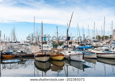 CANNES, FRANCE - JUNE 25, 2014: Row of yachts in the Port of Cannes. Cannes hosts the annual Cannes Film festival from 1949