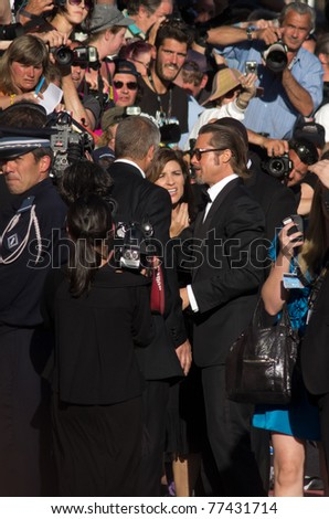 CANNES, FRANCE - MAY 16: Actor Brad Pitt says hello to fans at the  'The Tree Of Life' premiere during the 64th Annual Cannes Film Festival at Palais des Festivals on May 16, 2011 in Cannes, France - stock photo